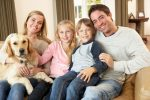 bigstock Happy young family sitting on 13921487