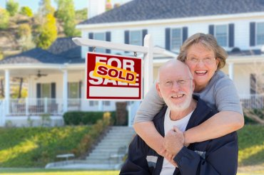 bigstock Senior Adult Couple in Front o 142143761