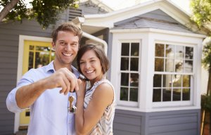 bigstock Couple With Keys Standing Outs 170307713 e1534183323243